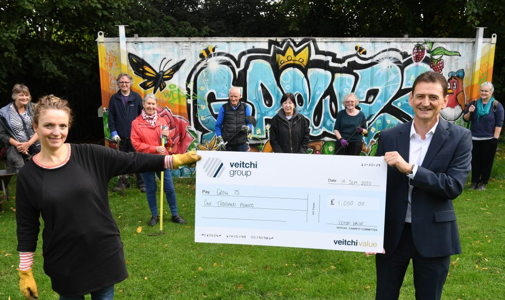 Cheque for £1000 to Grow 73